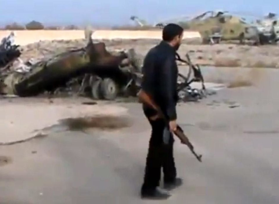 In this image taken from video obtained from the Ugarit News, which has been authenticated based on its contents and other AP reporting, Syrian rebels capture a helicopter air base near the capital Damascus after fierce fighting in Syria, on Sunday, Nov. 25, 2012. The takeover claim showed how rebels are advancing in the area of the capital, though they are badly outgunned by Assad's forces, making inroads where Assad's power was once unchallenged. Rebels have also been able to fire mortar rounds into Damascus recently. (AP Photo/Ugarit News via AP video)