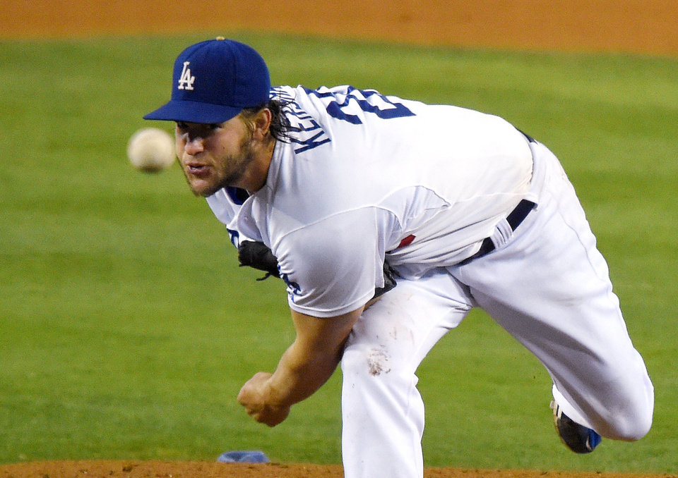 Photo - Los Angeles Dodgers starting pitcher Clayton Kershaw throws to the plate during the fourth inning of a baseball game against the Washington Nationals, Tuesday, Sept. 2, 2014, in Los Angeles. (AP Photo/Mark J. Terrill)