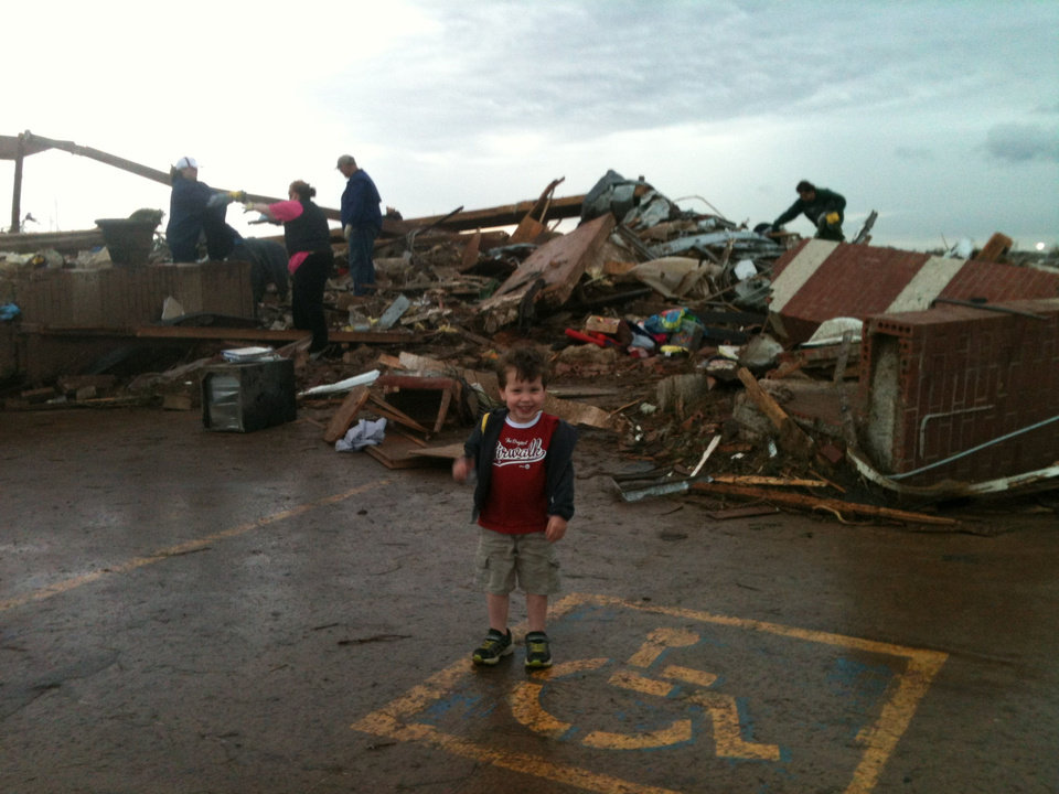 Brendan Workman, 3, stands in front of what\'s left of his school. Brendan and his mother, Shannon, were inside A Step Above Learning Center in south Oklahoma City when the torando struck the building. PROVIDED - PROVIDED