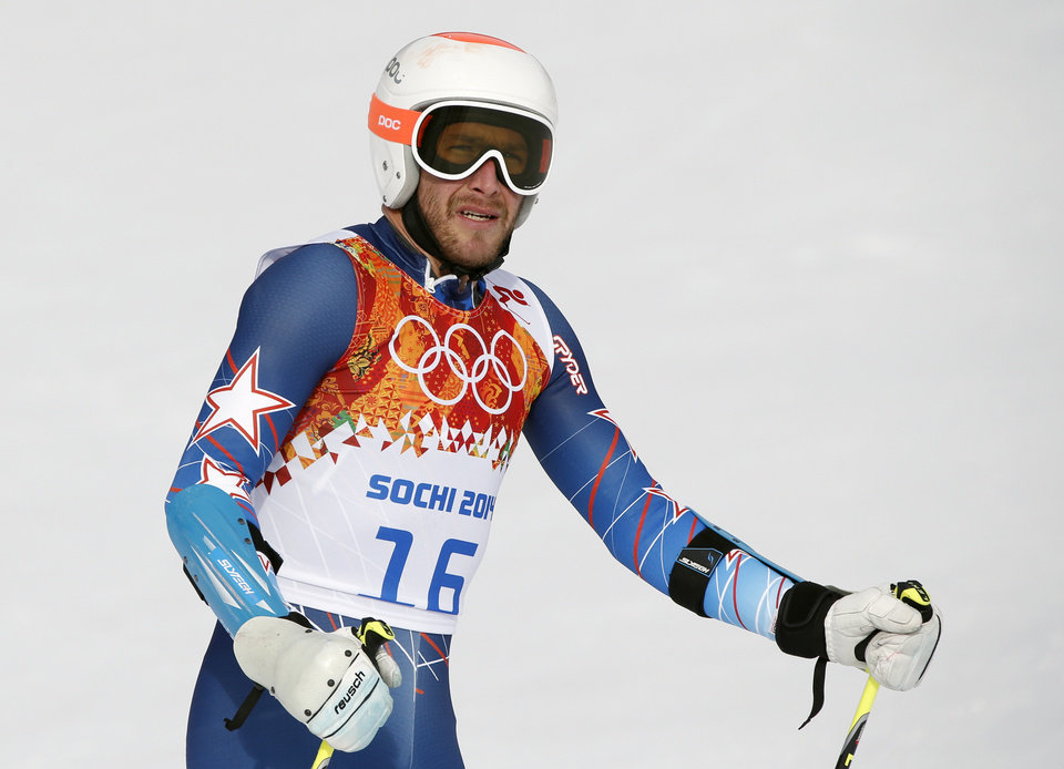 Photo - United States' Bode Miller arrives in the finish area after the first run of the men's giant slalom at the Sochi 2014 Winter Olympics, Wednesday, Feb. 19, 2014, in Krasnaya Polyana, Russia. (AP Photo/Christophe Ena)