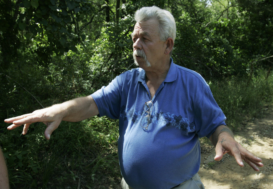 Photo - Joe Mosher talks with a reporter near the spot where his niece, Taylor Paschal-Placker, and her friend, Skyla Whitaker, were found murdered Sunday night, in Welettka, Okla., Wednesday, June 11, 2008. (AP Photo)