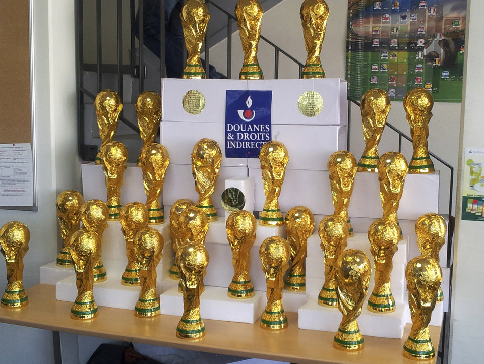 Photo - This photo taken on June 18, 2014 and provided Wednesday June 25, 2014 by the French Customs shows some World Cup counterfeit trophy replicas seized at Roissy airport, north of Paris. The 30 trophies were coming from China for the domestic market. (AP Photo/Douane Francaise)