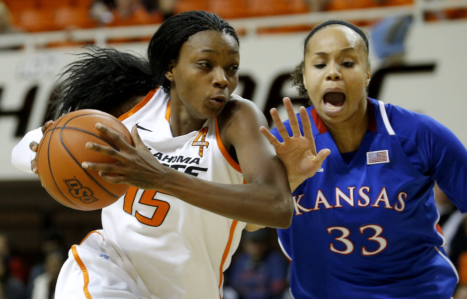 Photo - Oklahoma State's Toni Young (15) goes past Kansas' Tania Jackson (33) during a women's college basketball game between Oklahoma State University (OSU) and Kansas at Gallagher-Iba Arena in Stillwater, Okla., Tuesday, Jan. 8, 2013. Oklahoma State won 76-59. Photo by Bryan Terry, The Oklahoman