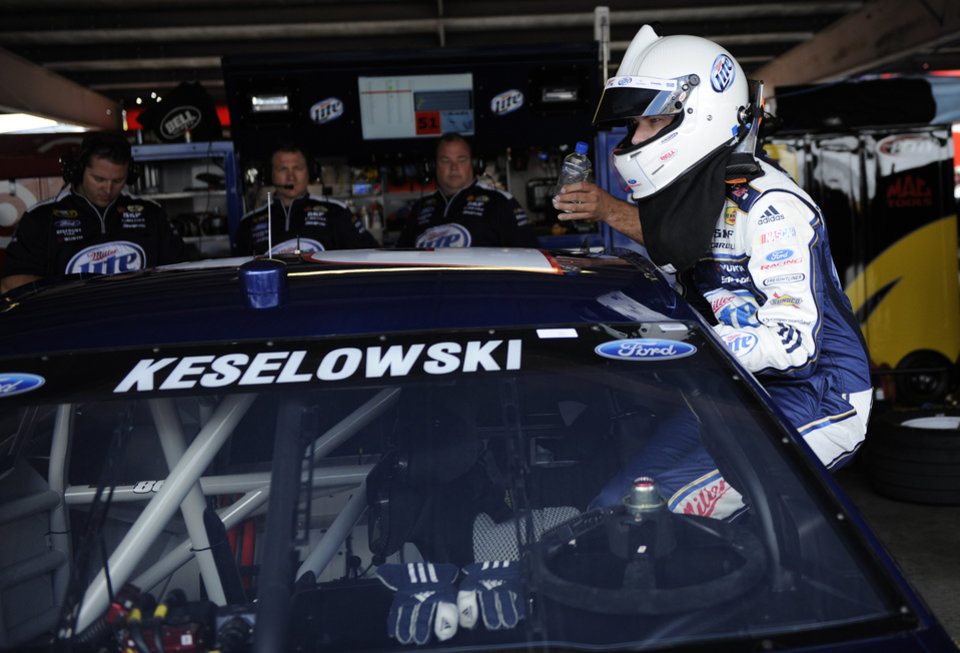Photo - Brad Keselowski climbs into his car during practice for Sunday's NASCAR Sprint Cup series auto race, Saturday, Sept. 28, 2013, at Dover International Speedway in Dover, Del. (AP Photo/Nick Wass)