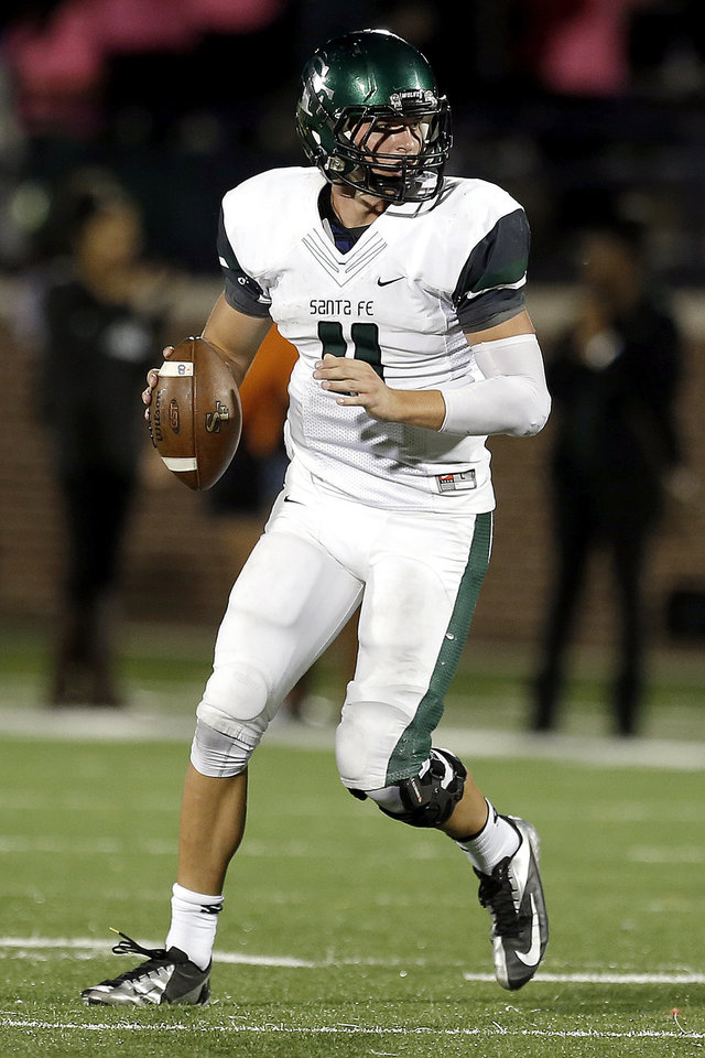 Photo - Edmond Santa Fe's Justice Hansen looks to pass the ball during the high school football game between Edmond North High School and Edmond Santa Fe High School at Wantland Stadium in Edmond, Okla.,  Friday, Sept. 20, 2013. Photo by Sarah Phipps, The Oklahoman