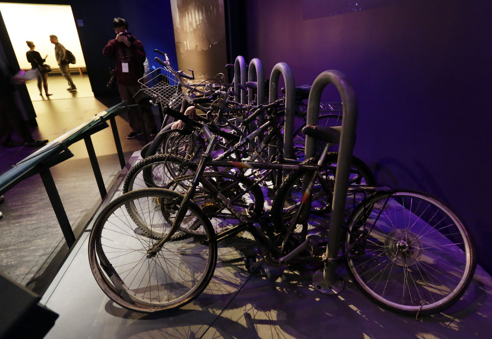 Photo - A salvaged bicycle rack, that was located on the northern edge of the World Trade Center site, is displayed at the National Sept. 11 Memorial Museum, Wednesday, May 14, 2014, in New York. The museum is a monument to how the Sept. 11 terror attacks shaped history, from its heart-wrenching artifacts to the underground space that houses them amid the remnants of the fallen twin towers' foundations. It also reflects the complexity of crafting a public understanding of the terrorist attacks and reconceiving ground zero.  (AP Photo)