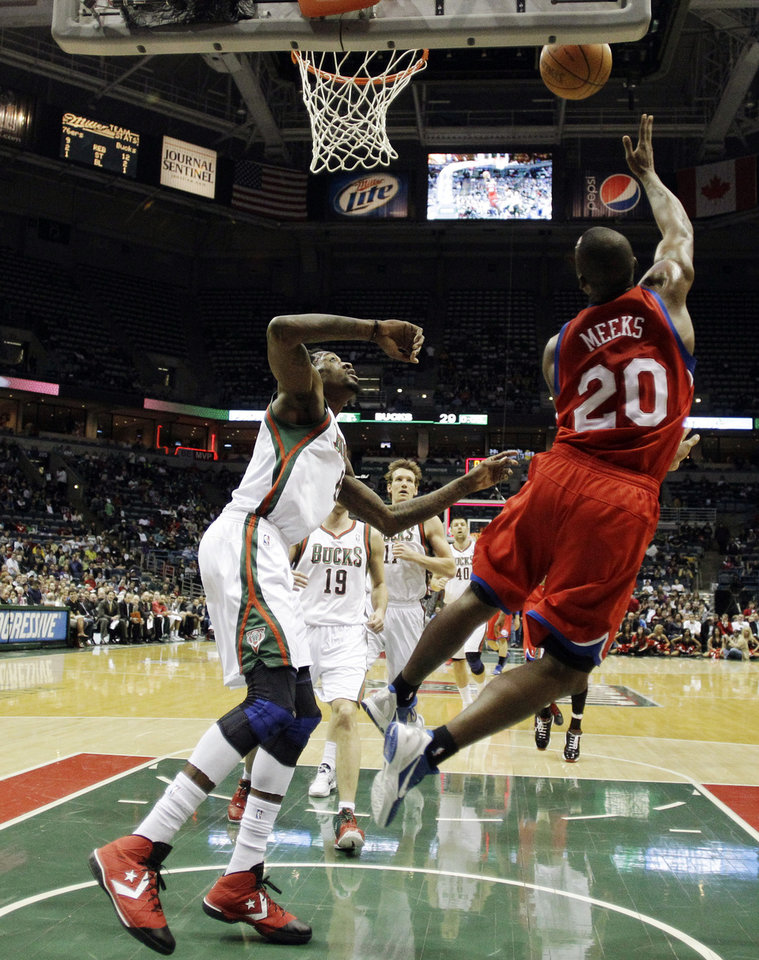 Photo -   Philadelphia 76ers' Jodie Meeks (20) shoots during the first half of an NBA basketball game against the Milwaukee Bucks, Wednesday, April 25, 2012, in Milwaukee. (AP Photo/Morry Gash)
