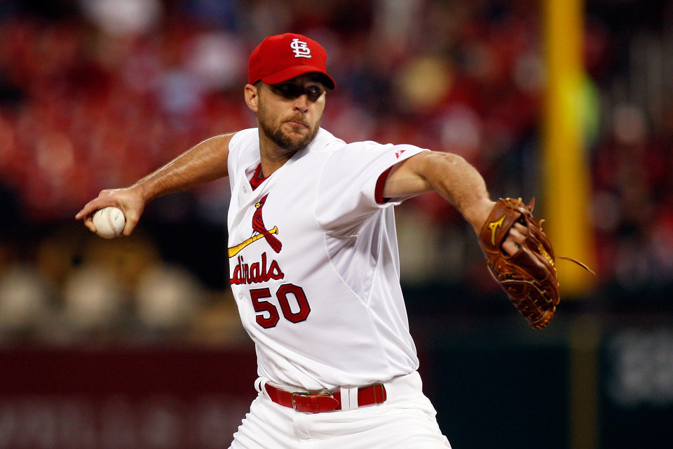 Photo - St. Louis Cardinals starting pitcher Adam Wainwright throws during the first inning of a baseball game against the Chicago Cubs on Tuesday, May 13, 2014, in St. Louis. (AP Photo/Scott Kane)