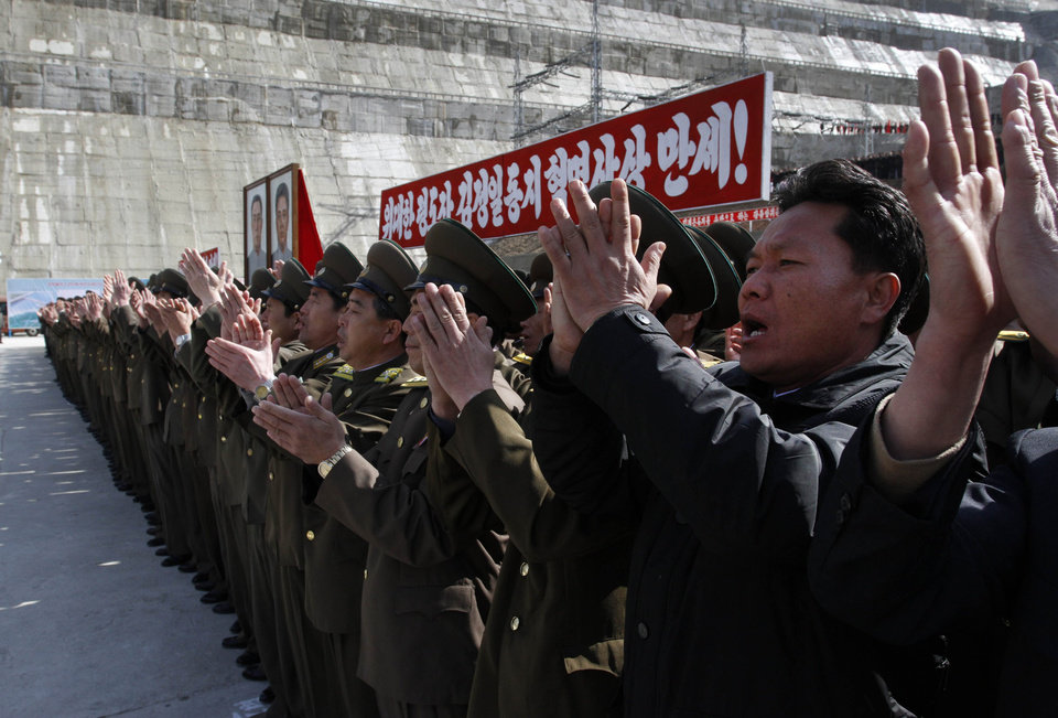 Photo -   Workers at the Huichon Power Station in Huichon City, some 250 kilometers (155 miles) north of the capital, Pyongyang, stand together and applaud during an opening ceremony for the facility Thursday, April 5, 2012. The Huichon Power Station, under construction for more than three years, was a favored project of late leader Kim Jong Il, who visited the project five times before his death in December. The opening was the first big ceremony in a month of celebrations timed for the April centenary of the birth of late President Kim Il Sung. (AP Photo/Kim Kwang Hyon)