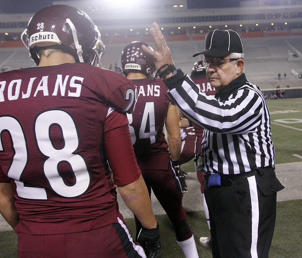 The official checks player uniforms during the Class 6A Oklahoma state championship football game between Norman North High School and Jenks High School at Boone Pickens Stadium on Friday, Nov. 30, 2012, in Stillwater, Okla.   Photo by Chris Landsberger, The Oklahoman