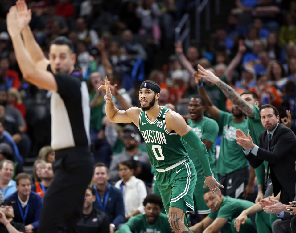 Photo - Boston's Jayson Tatum (0) celebrates a three-point shot in the third quarter during an NBA basketball game between the Oklahoma City Thunder and the Boston Celtics at Chesapeake Energy Arena in Oklahoma City, Sunday, Feb. 9, 2020. Boston won 112-111. [Nate Billings/The Oklahoman]