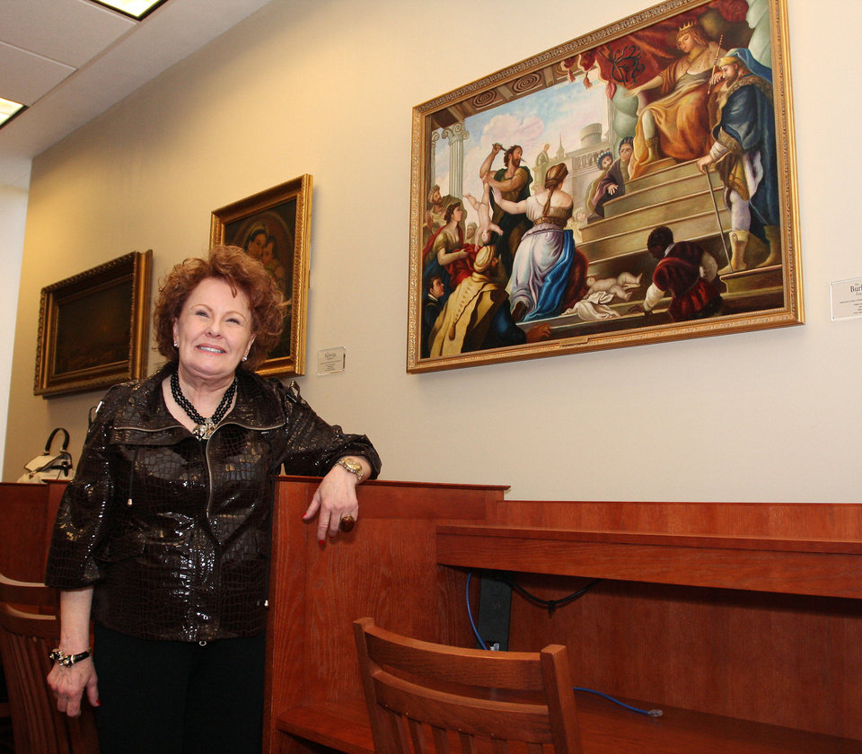 Bobbie Burbridge Lane poses with a painting from the collection she donated to Oklahoma City University and dedicated to seven of her special friends. Photo by David Faytinger, The Oklahoman