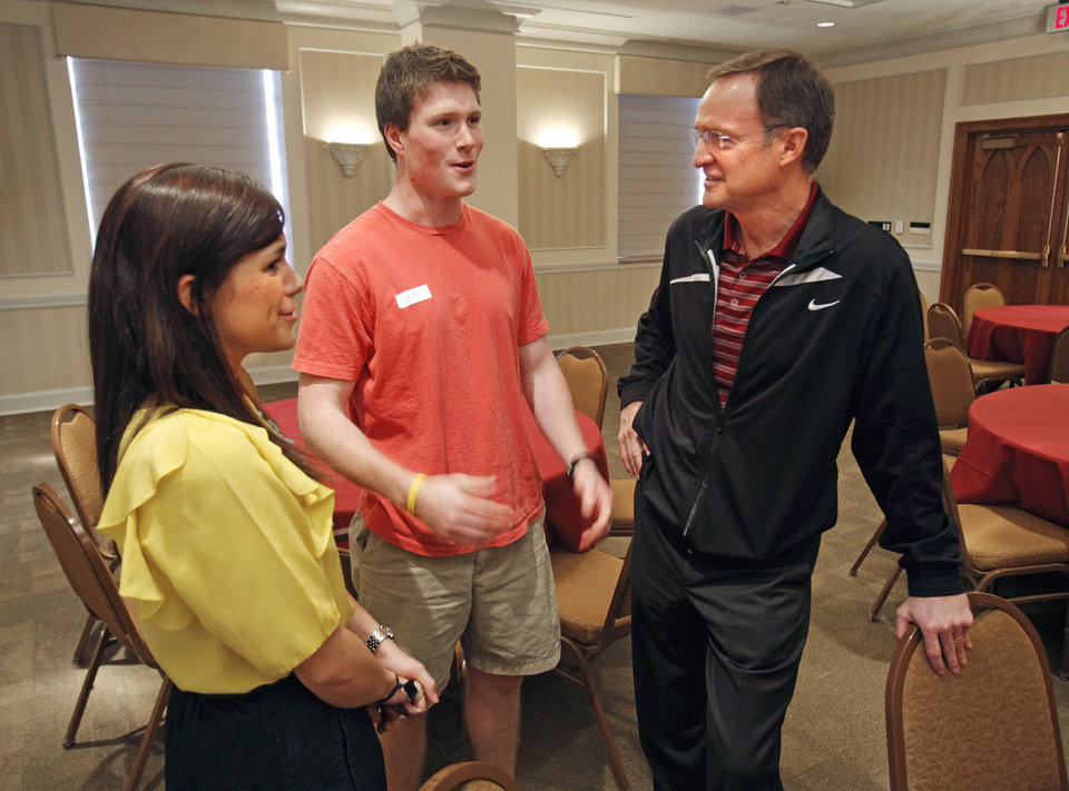 Sarah Rainey, Kappa Alpha Theta Junior from Edmond and Nick Coffey, Beta Theta Pi president and Oklahoma City sophomore, talk with University of Oklahoma (OU) head college basketball coach Lon Kruger at a lunch with fraternity and sorority members on Thursday, April 28, 2011, in Norman, Okla.   Photo by Steve Sisney, The Oklahoman ORG XMIT: KOD