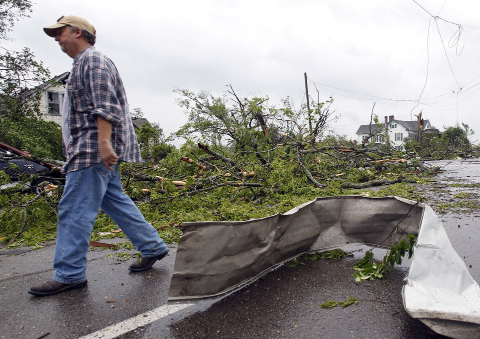 Photo - Butch Stringer surveys damage to his home after a tornado hits downtown Culman, Ala., on Wednesday, April 27, 2011. (AP Photo/Butch Dill)