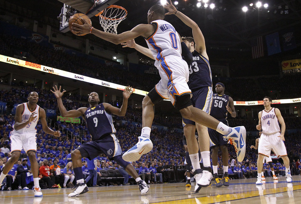 Photo - Oklahoma City's Russell Westbrook (0) passes the ball to Oklahoma City's Kevin Durant (35) during game two of the Western Conference semifinals between the Memphis Grizzlies and the Oklahoma City Thunder in the NBA basketball playoffs at Oklahoma City Arena in Oklahoma City, Tuesday, May 3, 2011. Photo by Chris Landsberger, The Oklahoman