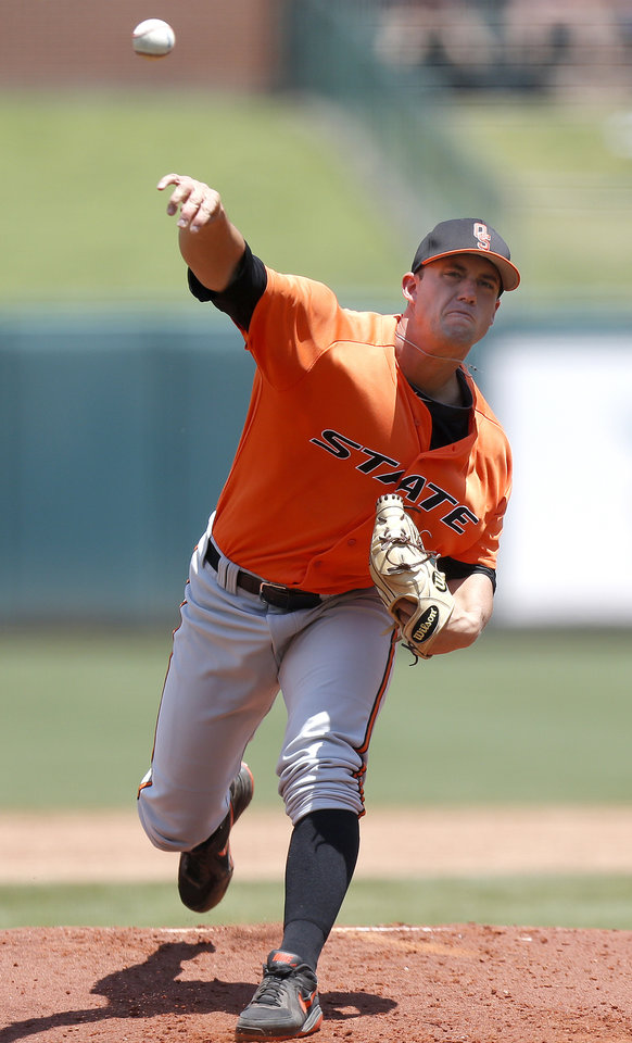 Photo - Oklahoma State's Mark Robinette throws a pitch during the Bedlam baseball game between the University of Oklahoma and Oklahoma State University at the Chickasaw Bricktown Ballpark in Oklahoma CIty, Sunday, May 12, 2013. Photo by Sarah Phipps, The Oklahoman