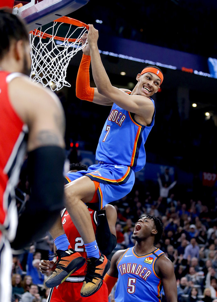 Photo - Oklahoma City's Darius Bazley (7) reacts after a dunk during the NBA basketball game between the Oklahoma City Thunder and the Portland Trail Blazers at the Chesapeake Energy Arena in Oklahoma City, Saturday, Jan. 18, 2020.  [Sarah Phipps/The Oklahoman]