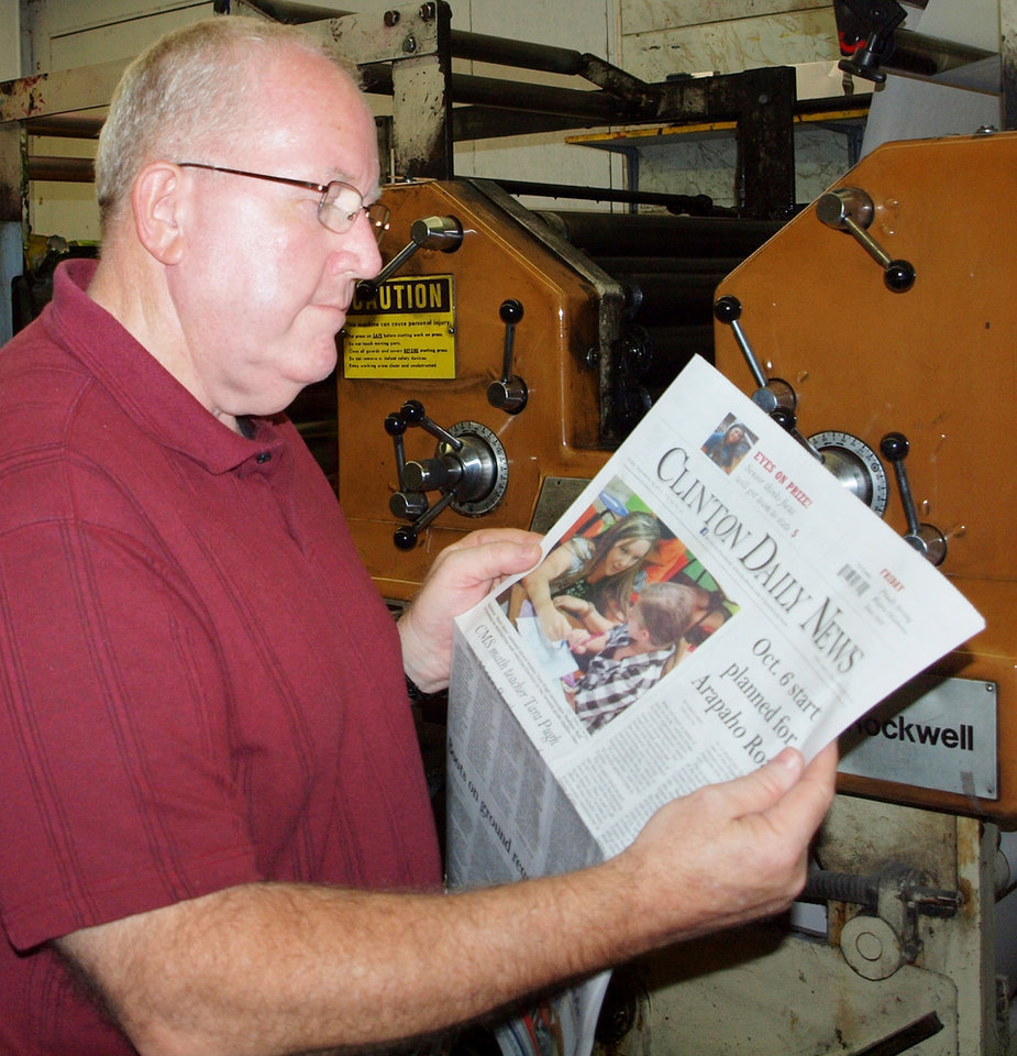 Photo -  Rod Serfoss, 59, reads the Clinton Daily News. Photo provided   PROVIDED -