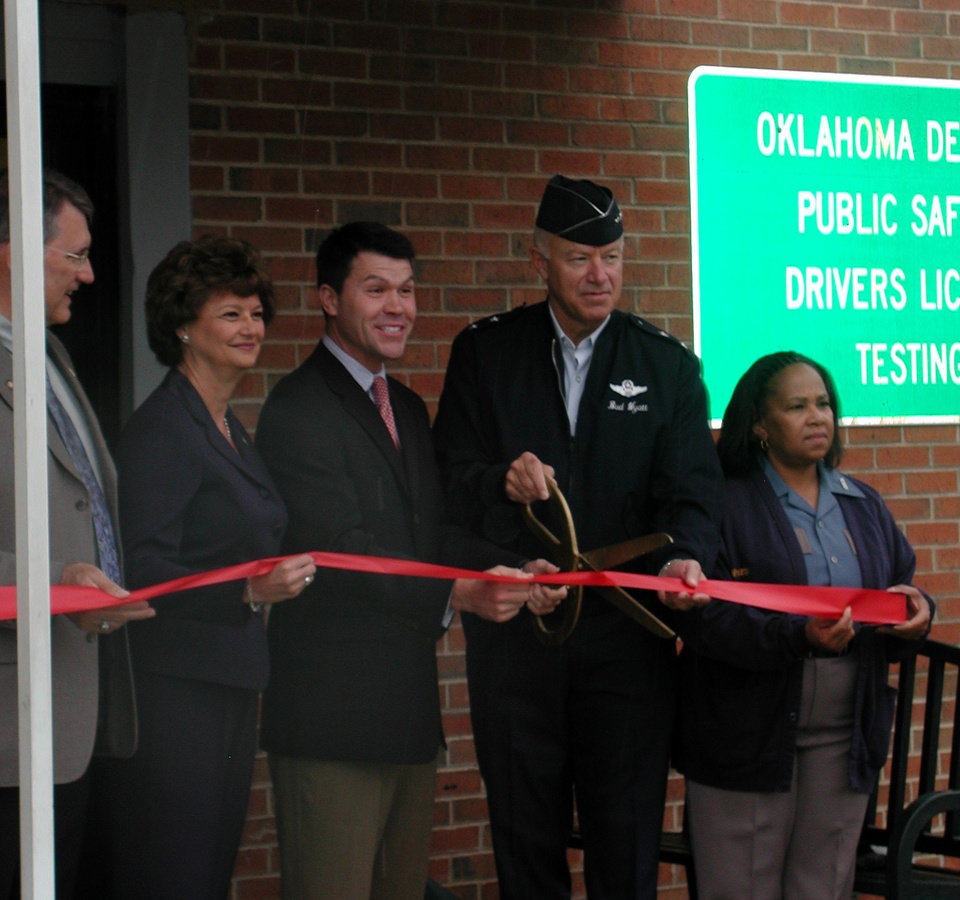 Left to Right State Rep. Gary Banz, DPS Driver License Examining Director Karen Gentry, Commissioner Jim Roth, Major General Bud Wyatt, Commander Oklahoma Army and Air National Guard, and an unidentified woman cut the ribbon for the re-opening of Air Depot Blvd. north of 23rd street in Midwest City.<br/><b>Community Photo By:</b> Oklahoma County District 1<br/><b>Submitted By:</b> joe, norman