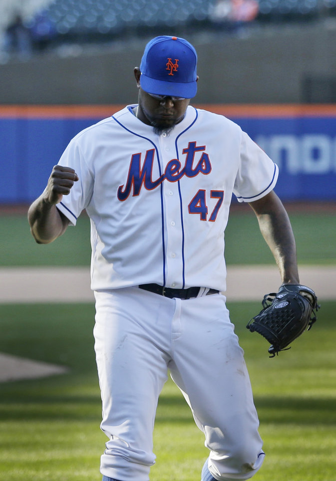 Photo - New York Mets relief pitcher Jose Valverde reacts after the Mets turned a double play to end the top of the fourteenth inning of the baseball game against the Atlanta Braves at Citi Field, Sunday, April 20, 2014 in New York. The Mets defeated the Braves in extra innings 4-3. (AP Photo/Seth Wenig)
