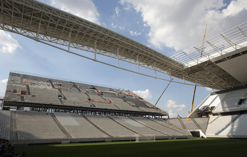 Photo - Men work on the Itaquerao stadium in Sao Paulo, Brazil, Thursday, May 8, 2014. The still unfinished stadium will host the World Cup opener match between Brazil and Croatia on June 12. (AP Photo/Andre Penner)