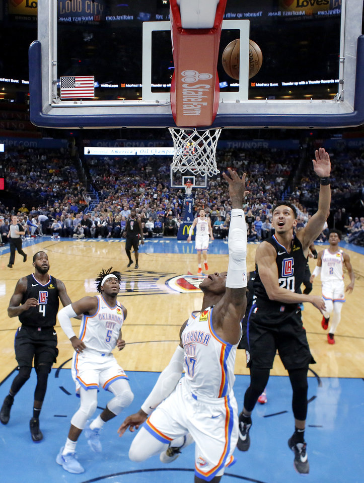 Photo - Oklahoma City's Dennis Schroder (17) goes to the basket past LA's Landry Shamet (20) during an NBA basketball game between the Oklahoma City Thunder and the Los Angeles Clippers at Chesapeake Energy Arena in Oklahoma City, Tuesday, March 3, 2020. [Bryan Terry/The Oklahoman]
