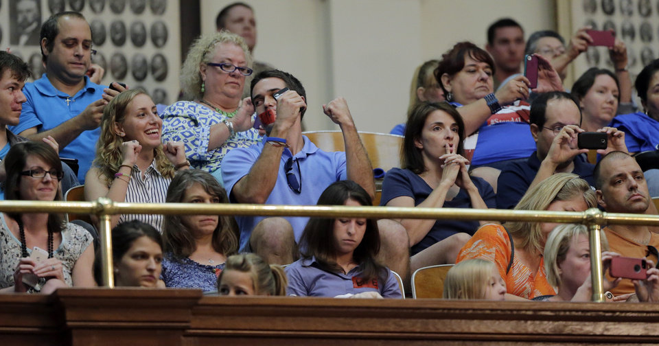 Photo - ADDS THAT BILL IS PROVISIONALLY APPROVED, WITH FINAL VOTE SCHEDULED FOR WEDNESDAY - Supporters of HB 2, an abortion bill, react in the gallery of the Texas House after the bill was provisionally approved, Tuesday, July 9, 2013, in Austin, Texas. A final, formal vote is scheduled for Wednesday. The bill  would require doctors to have admitting privileges at nearby hospitals, only allow abortions in surgical centers, dictate when abortion pills are taken and ban abortions after 20 weeks. (AP Photo/Eric Gay)