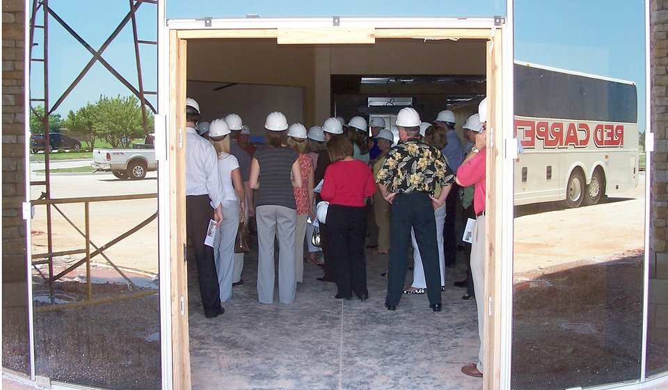 "Photo - Realtors and others on a commercial real estate bus tour listen to a presentation just inside the lobby of Centennial Plaza, a ""green"" office building under construction by Aduddell Development Group at Kelley Pointe in Edmond in this photo from 2007. Photo by RICHARD MIZE, The Oklahoman archive"