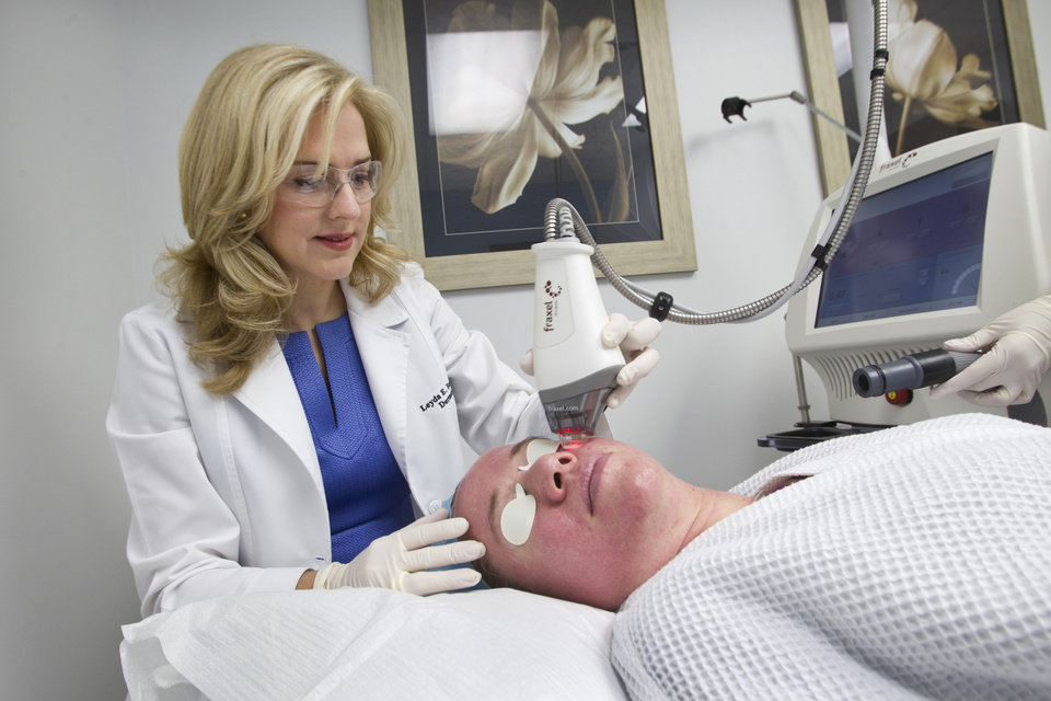 Photo - Dr. Leyda E. Bowens performs a Fraxel Laser treatment for wrinkles and acne scars. (C.W. Griffin/Miami Herald/MCT)