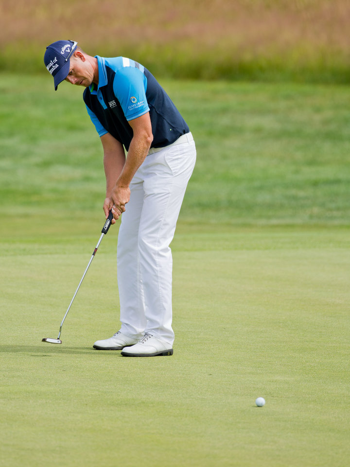 Photo - Sweden's Henrik Stenson putts  during the  BMW International Open golf tournament  in Pulheim near Cologne, Germany,  Friday June 27, 2014.  (AP Photo/dpa,Rolf Vennenbernd)