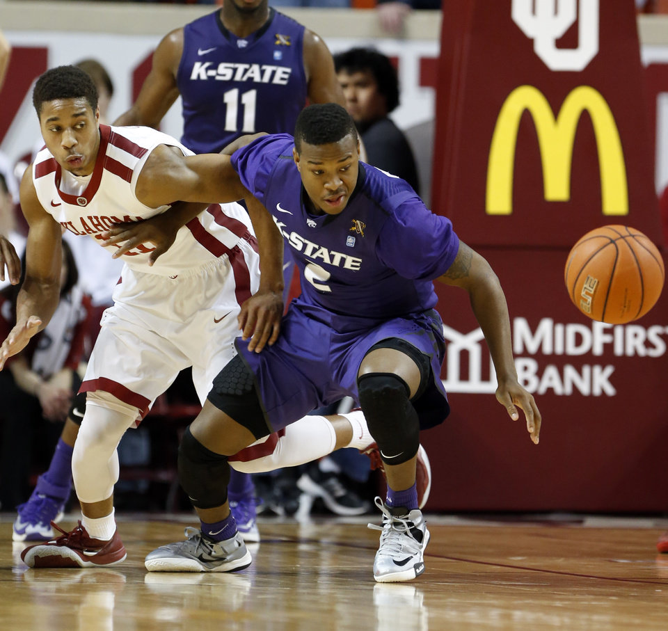 Photo - Kansas State Wildcat's Marcus Foster (2) pushes Oklahoma Sooner's Isaiah Cousins (11) as they try for a loose ball as the University of Oklahoma Sooner (OU) men play the Kansas State Wildcats (KS) in NCAA, college basketball at The Lloyd Noble Center on Saturday, Feb. 22, 2014 in Norman, Okla. Photo by Steve Sisney, The Oklahoman