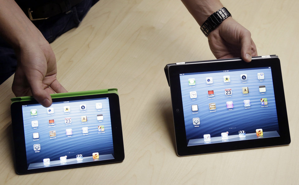 The Apple iPad Mini, at left, is shown next to the fourth-generation iPad on Tuesday in San Jose, Calif. AP Photo <strong>Marcio Jose Sanchez</strong>
