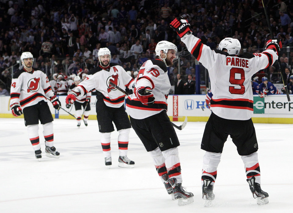 Photo -   New Jersey Devils' Zach Parise, right, celebrates with teammates, from left, Bryce Salvador, Ilya Kovalchuk, of Russia, and Travis Zajac after scoring against the New York Rangers during the third period of Game 5 of an NHL hockey Stanley Cup Eastern Conference final playoff series, Wednesday, May 23, 2012, in New York. The Devils won 5-3. (AP Photo/Frank Franklin II)