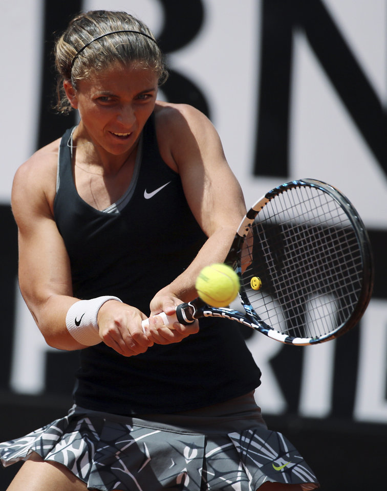 Photo - Italy's Sara Errani, returns the ball during the final match against Serena Williams, at the Italian open tennis tournament in Rome, Sunday, May 18, 2014. Serena Williams kept the crowd from being a factor in a 6-3, 6-0 victory over 10th-seeded Sara Errani to win the Italian Open for the third time Sunday. (AP Photo/Gregorio Borgia)