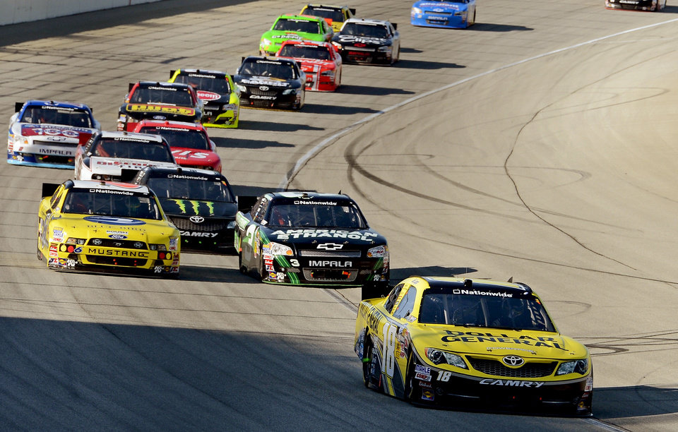 Photo -   Joey Logano (18) leads the pack during the NASCAR Nationwide Series auto race at Chicagoland Speedway in Joliet, Ill., Saturday, Sept. 15, 2012. (AP Photo/Warren Wimmer)