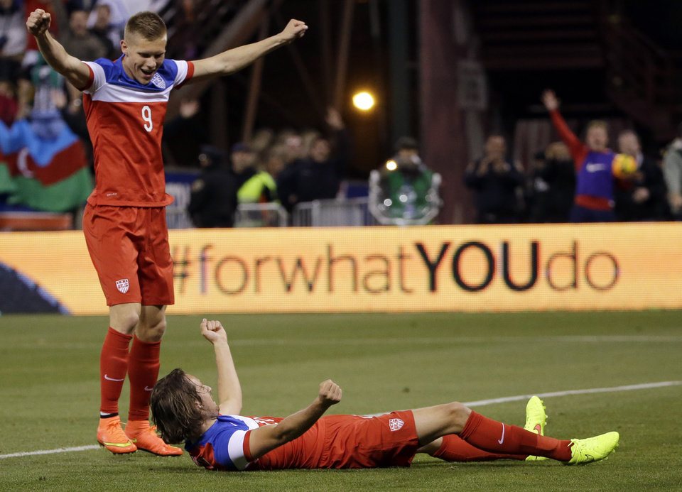 Photo - United States' Mix Diskerud, bottom, celebrates his goal with teammate Aron Johannsson, left, during the second half of an international friendly soccer match against Azerbaijan on Tuesday, May 27, 2014, in San Francisco. United States won 2-0. (AP Photo/Marcio Jose Sanchez)