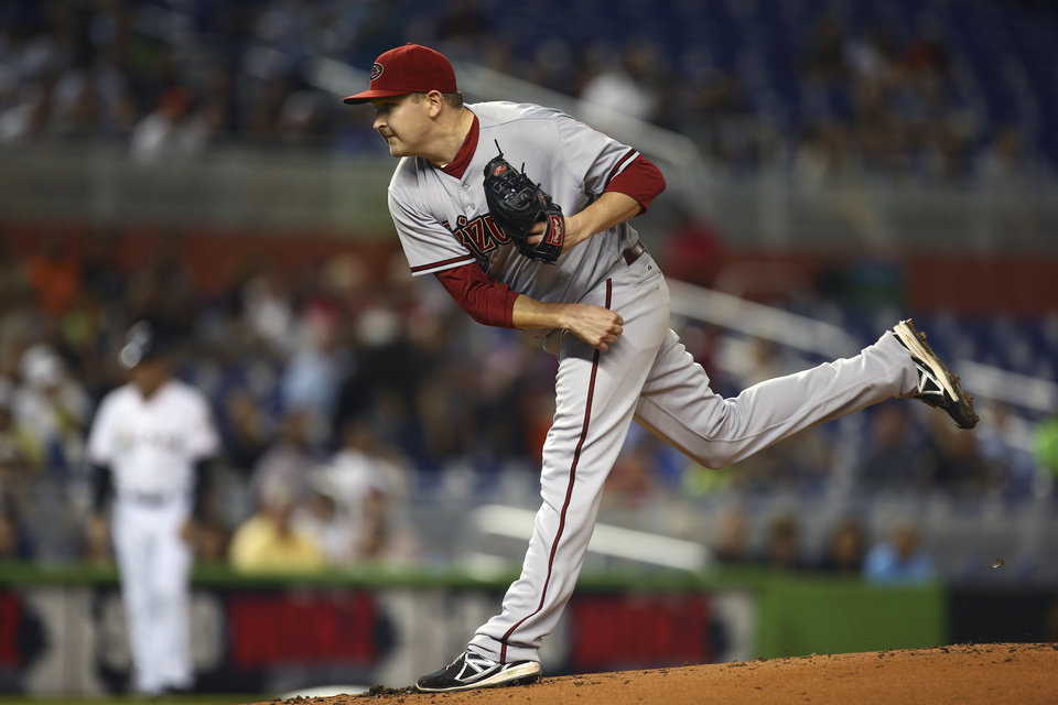 Photo - Arizona Diamondbacks starter Trevor Hill pitches to the Miami Marlins during the first inning of a baseball game in Miami, Friday, Aug. 15, 2014. (AP Photo/J Pat Carter)