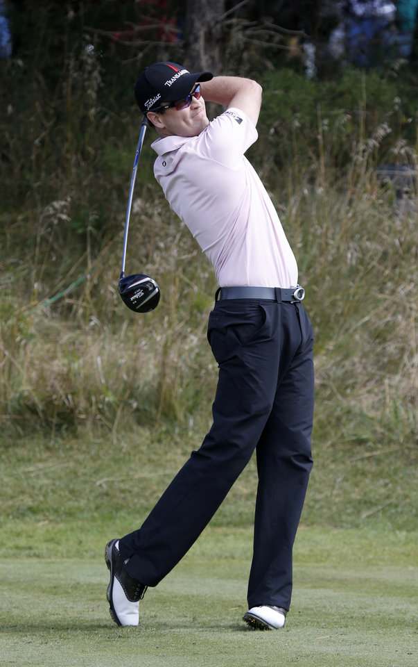 Photo - Zach Johnson watches his tee shot on the 14th hole during the final round of the BMW Championship golf tournament at Conway Farms Golf Club, Monday, Sept. 16, 2013, in Lake Forest, Ill. (AP Photo/Charles Rex Arbogast)