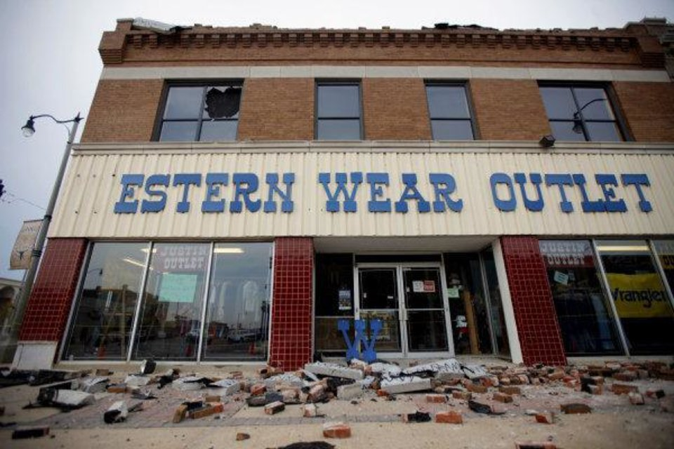 Debris is scattered on the ground in front of the Western Wear Outlet store in Stockyards City after a storm passed through the Oklahoma CIty area on Wednesday, August 3, 2011. Photo by Bryan Terry, The Oklahoman ORG XMIT: KOD