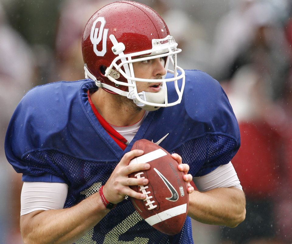 Photo - Quarterback Landry Jones rolls out for a pass during the spring Red and White football game for the University of Oklahoma (OU) Sooners at Gaylord Family/Oklahoma Memorial Stadium on Saturday, April 17, 2010, in Norman, Okla.  Photo by Steve Sisney, The Oklahoman