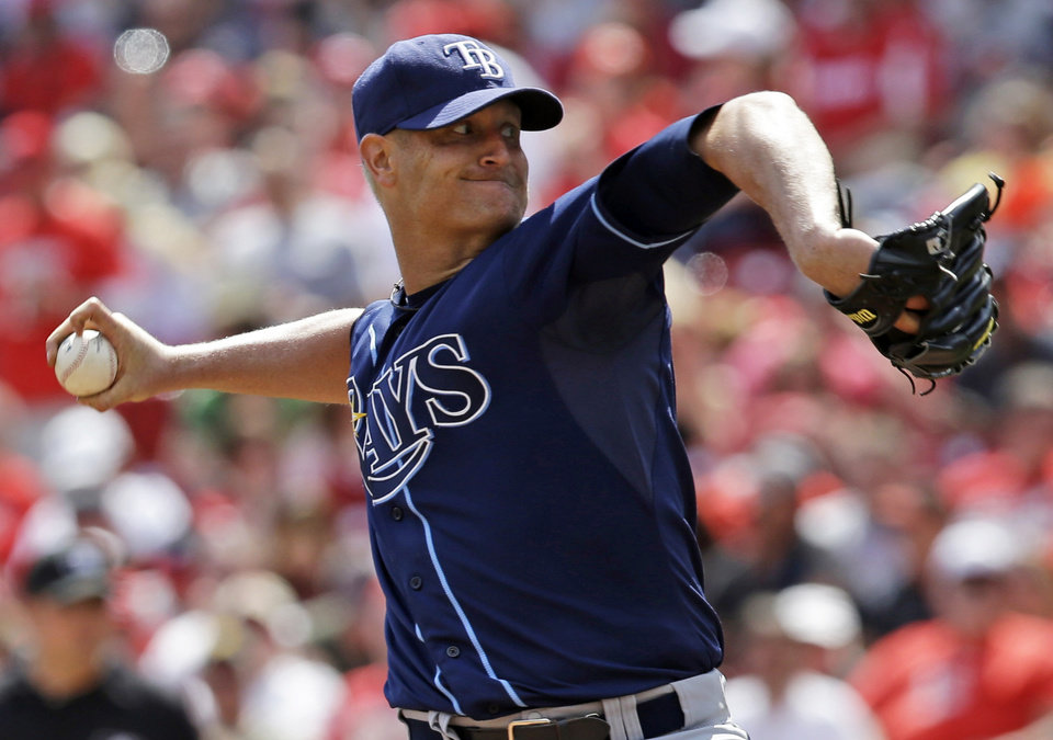 Photo - Tampa Bay Rays starting pitcher Alex Cobb throws against the Cincinnati Reds in the sixth inning of a baseball game, Saturday, April 12, 2014, in Cincinnati. Cobb pitched seven shutout innings to earn the 1-0 win. (AP Photo/Al Behrman)