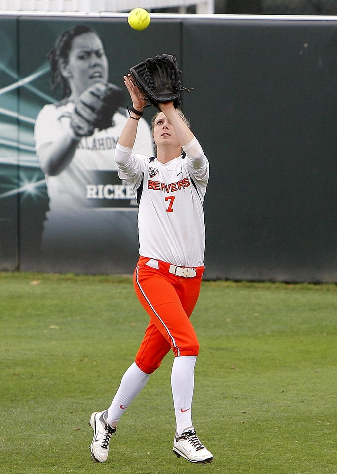 Photo - Oregon State's Hannah Bouska catches a fly ball during an NCAA softball regional between the University of Oklahoma and  Oregon State in Norman, Okla., Sunday, May 20, 2012. Photo by Sarah Phipps, The Oklahoman