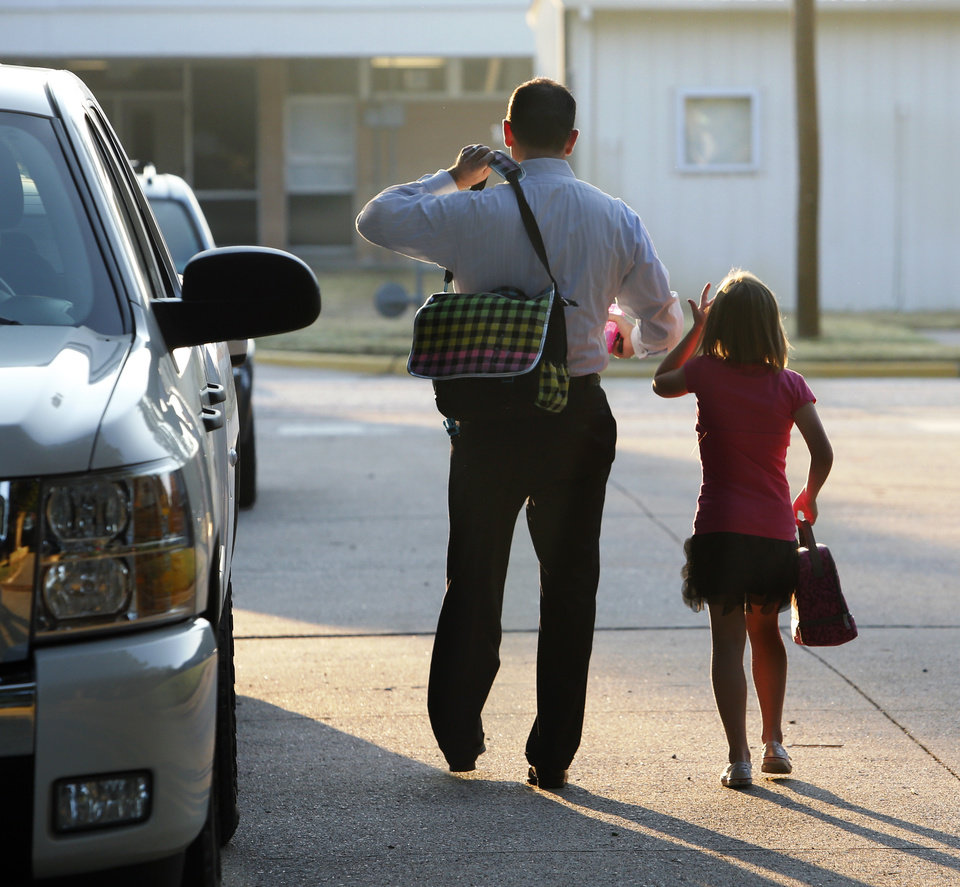 Brian McPherson walks new third-grader, daughter Chloe to school as students arrive for the first day of class at Monroe Elementary School on Wednesday, Aug. 22, 2012 in Norman, Okla.  Photo by Steve Sisney, The Oklahoman