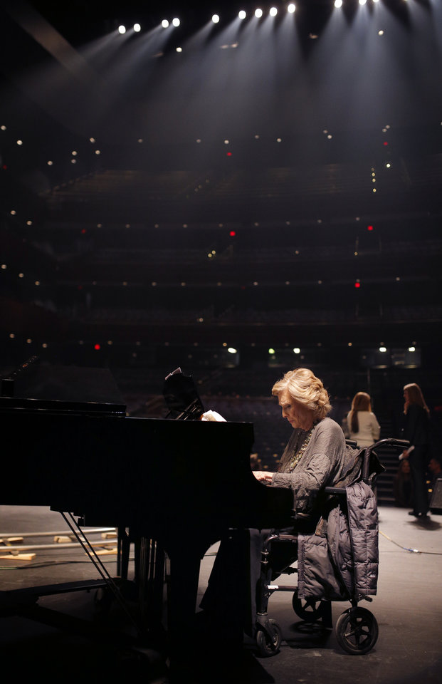 Photo -  Cloris Leachman plays the piano Jan. 12 on the set of