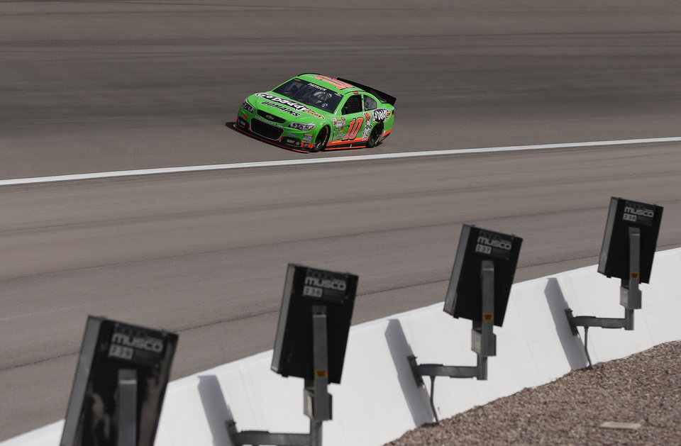 Photo - Danica Patrick comes out of turn four during practice for the NASCAR Sprint Cup Series race, Saturday, March 9, 2013 in Las Vegas. (AP Photo/Julie Jacobson)