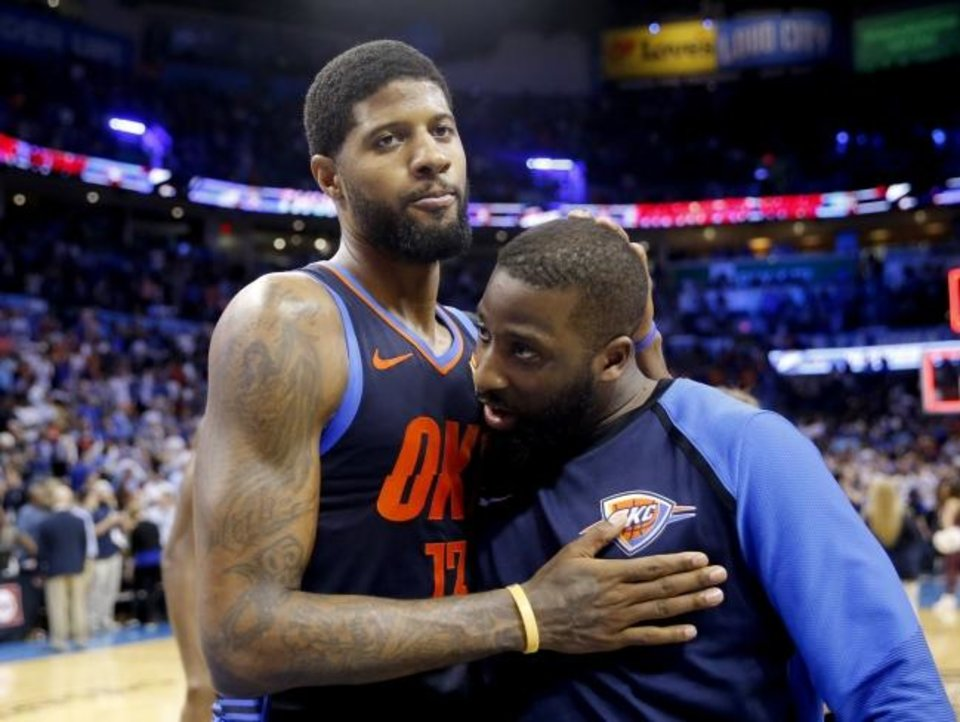 Photo -  Paul George, left, celebrates with Raymond Felton after the Thunder's 112-111 win against the Rockets on Tuesday. [Sarah Phipps/The Oklahoman]