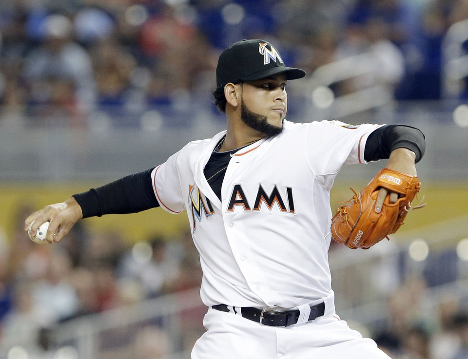 Photo - Miami Marlins' Henderson Alvarez delivers a pitch during the first inning of a baseball game against the Philadelphia Phillies, Tuesday, July 1, 2014, in Miami. (AP Photo/Wilfredo Lee)