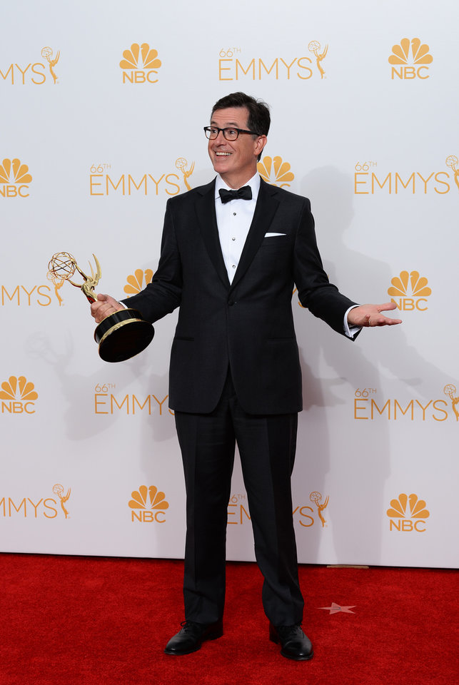 Photo - Stephen Colbert poses with the award for Outstanding Variety Series in the press room at the 66th Annual Primetime Emmy Awards at the Nokia Theatre L.A. Live on Monday, Aug. 25, 2014, in Los Angeles. (Photo by Jordan Strauss/Invision/AP)