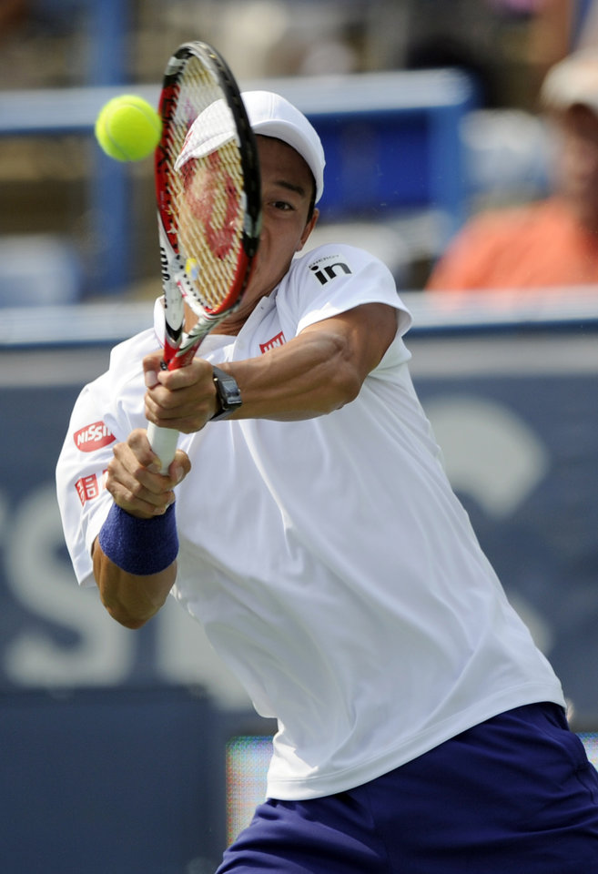 Photo - Kei Nishikori, of Japan, returns the ball against Sam Querrey during a match at the Citi Open tennis tournament, Wednesday, July 30, 2014, in Washington. (AP Photo/Nick Wass)