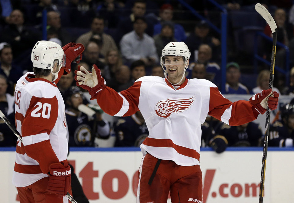 Detroit Red Wings' Jakub Kindl, of the Czech Republic, is congratulated by Drew Miller, left, after scoring during the first period of an NHL hockey game against the St. Louis Blues on Thursday, Feb. 7, 2013, in St. Louis. (AP Photo/Jeff Roberson)